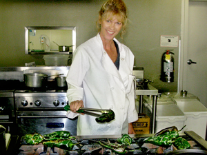Cathy roasting peppers at school