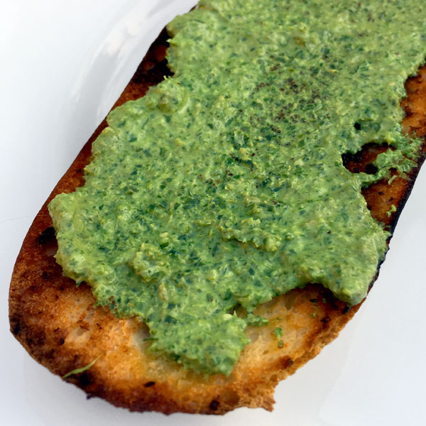 Creamy carrot top pesto on bread