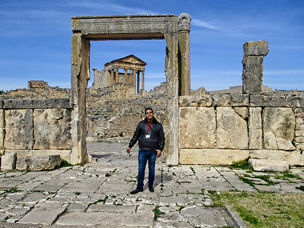 Tour guide Ghazi Zaroui in front of Dougga