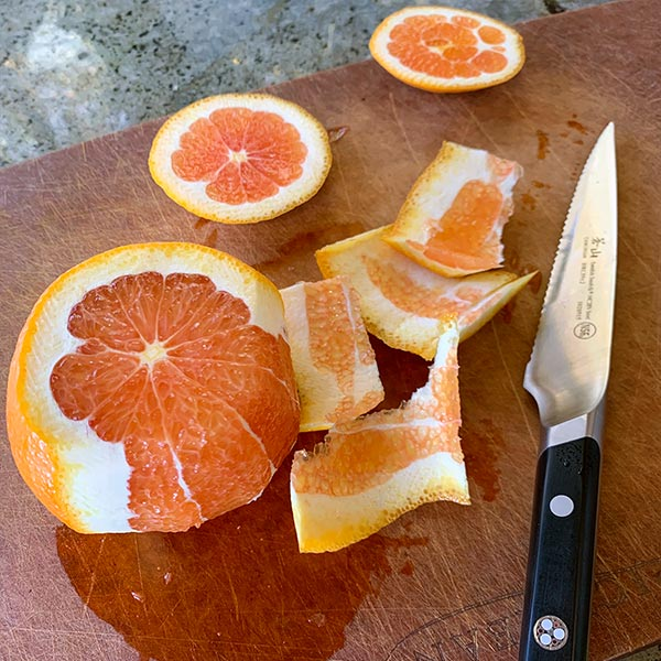 cara cara oranges being cut with Cangshan Cutlery