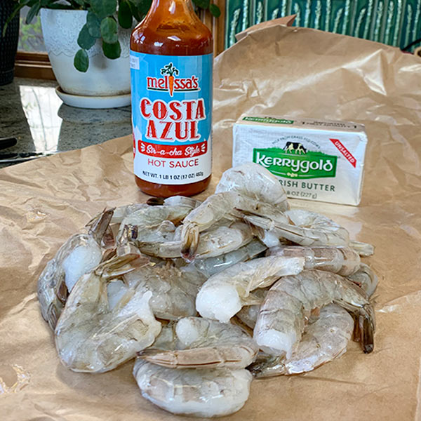Costa azul hot sauce, Kerrygold butter and Shrimp for Spicy Shrimp Tacos with Orange and Grape Salsa
