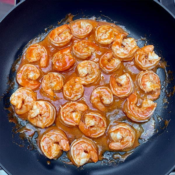 Shrimp being cooked in Costa Azul hot sauce