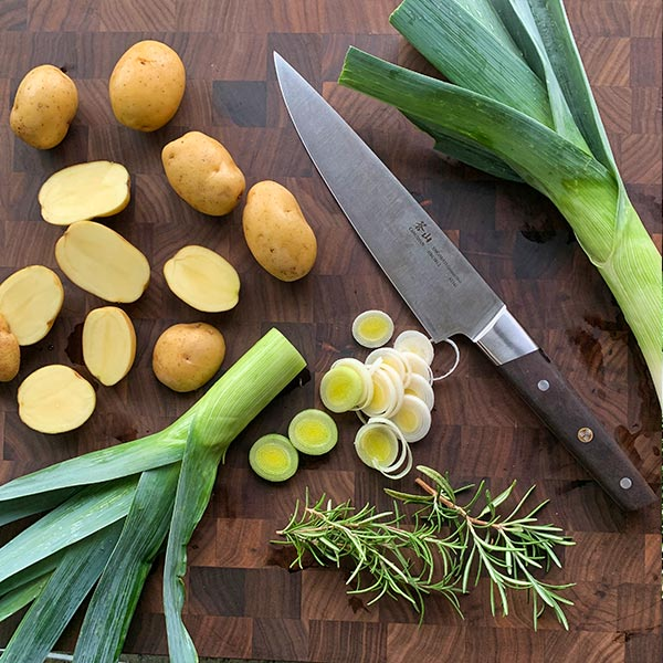Cut Baby Dutch Yellow Potatoes and leeks with knife from Cangshan Cutlery